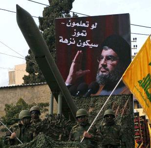 Członkowie libańskiego Hezbollahu podczas demonstracji w Nabatiyeh, 10.01.2009