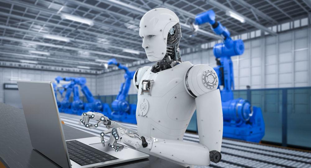 Robot pracujący za komputerem w zakładzie przyszłości