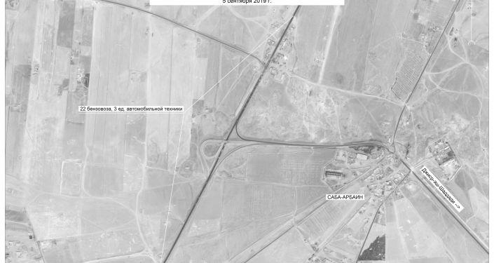 Samochody i cysterny w okolicy miasta Asz-Szaddada