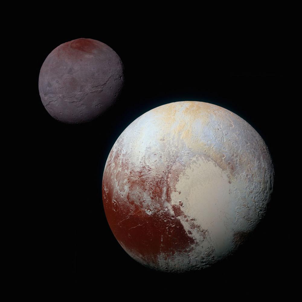 Kolorowe zdjęcie Plutona oraz jego największej satelity Charona