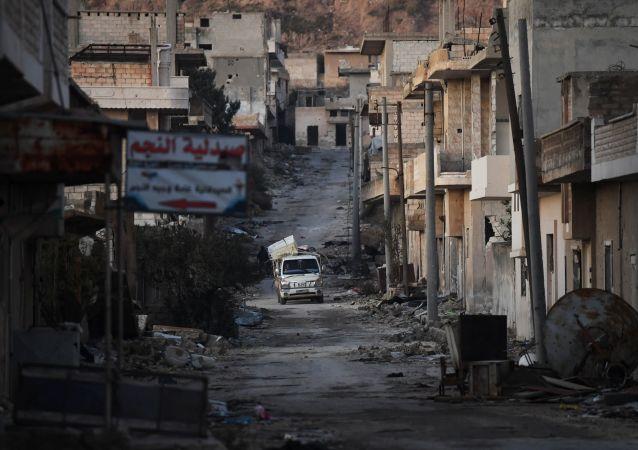 Zniszczone domy w syryjskim mieście Chan Szejchun