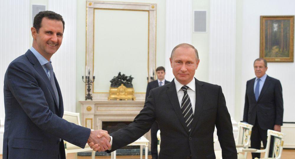 Prezydent Syrii Baszar al-Asad i prezydent Rosji Władimir Putin na spotkaniu w Kremlu