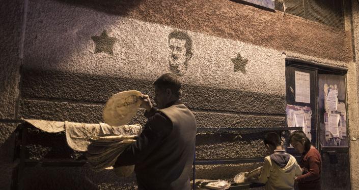 Ludzie przy piekarni w Damaszku