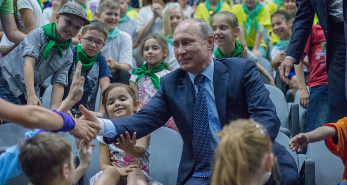President Vladimir Putin talks to children during his visit to the Mosquarium Center of Oceanography and Marine Biology at VDNKh