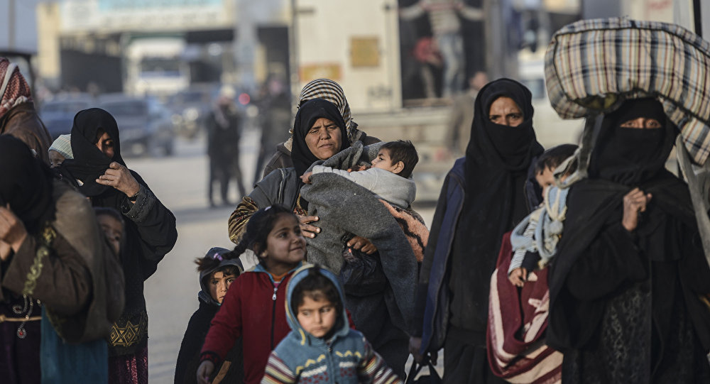 Syryjscy uchodźcy na turecko-syryjskiej granicy