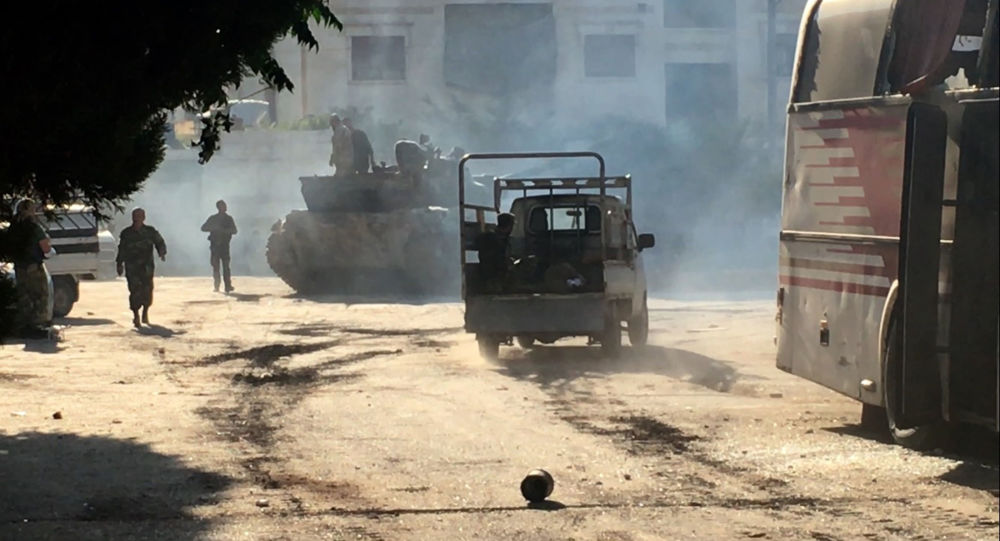 Bojownicy armii syryjskiej w czasie ofensywy w rejonie Aleppo