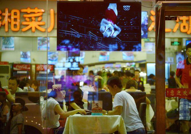 Klienci w restauracji w Pekinie
