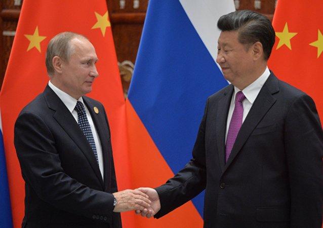 Prezydent Rosji Władimir Putin i przewodniczący ChRL Xi Jinping w trakcie szczytu G20 w Hangzhou