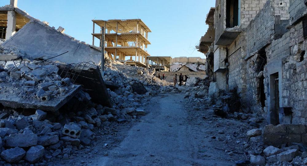 Powstańcy w wyzwolonym obozie palestyńskich uchodźców Handarat na północnym wschodzie Aleppo