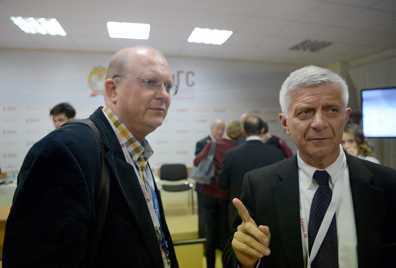 Premier Polski w latach 2004-2005 Marek Belka i komentator Sputnika Leonid Swiridow