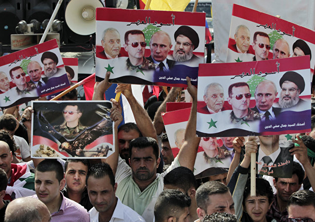 Syrians who lives in Lebanon hold posters with photos of Syrian President Bashar Assad, Russian President Vladimir Putin, Hezbollah leader Sheikh Hassan Nasrallah, and Lebanese Parliament Speaker Nabih Berri, with Arabic that reads Lions of the time, during a rally to thank Moscow for its intervention in Syria, in front of the Russian embassy in Beirut, Lebanon, Sunday, Oct. 18, 2015