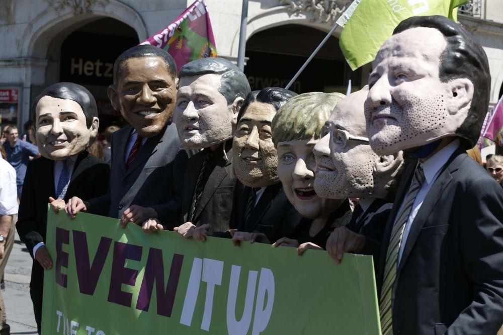 Karykatury przywódców państw tworzących G7.