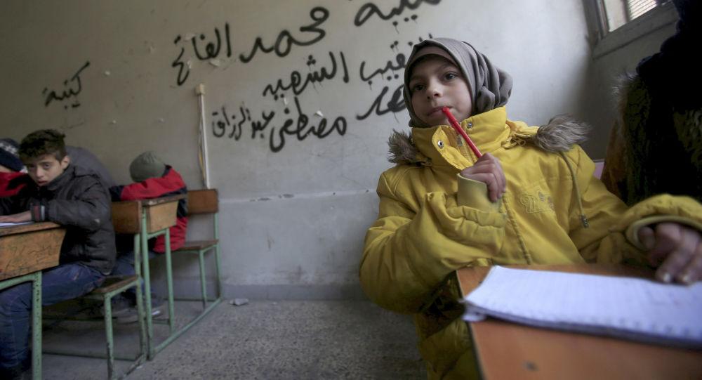 Dzieci na lekcji w Aleppo