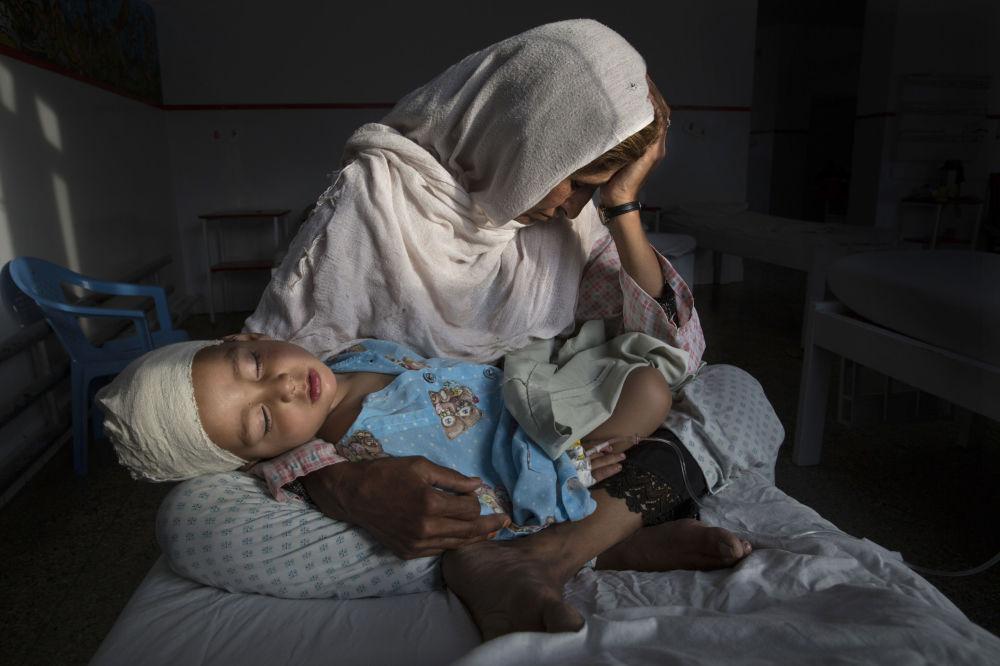 Zdjęcie Milczące ofiary zapomnianej wojny. Autor: Paula Bronstein. Pierwsze miejsce w kategorii Życie codzienne - zdjęcie pojedyncze.