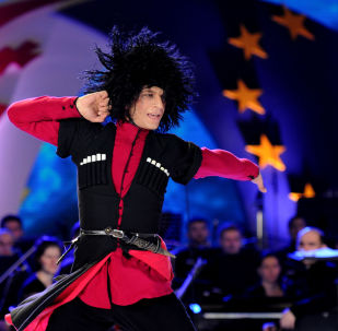 Gruzińscy tancerze w Tbilisi na koncercie z okazji podpisania porozumienia z UE