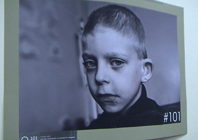 Twarze dzieci wojny: Berlińska wystawa fotograficzna o walkach w Donbasie