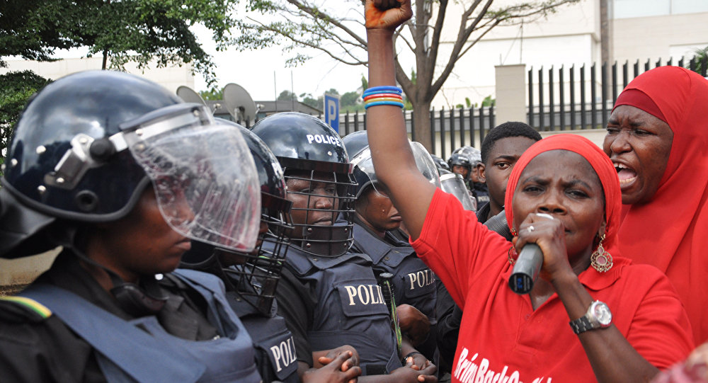 Police women in riot gear block the route during a demonstration calling on the government to rescue the kidnapped girls of the government secondary school in Chibok, in Abuja, Nigeria, Tuesday, Oct. 14, 2014.