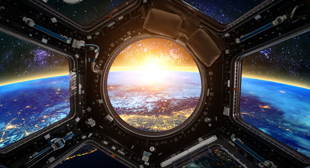 Widok na Ziemię z iluminatora statku kosmicznego