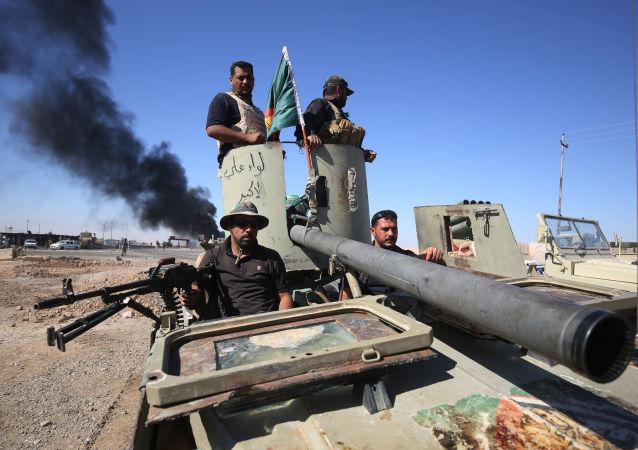 Iraccy wojskowi w czasie operacji wyzwolenia Al-Hawidży