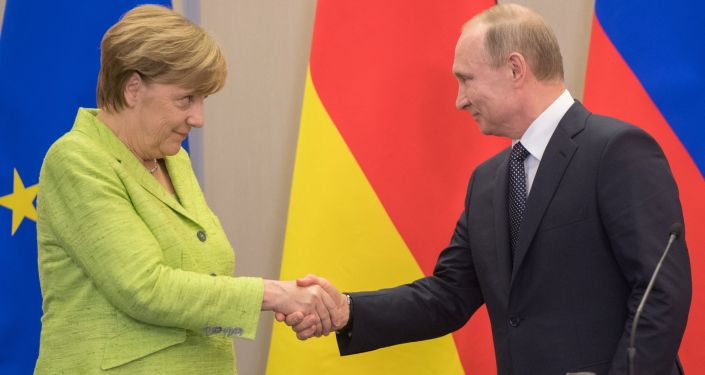 Kanclerz Niemiec Angela Merkel i prezydent Rosji Władimir Putin w czasie konferencji prasowej