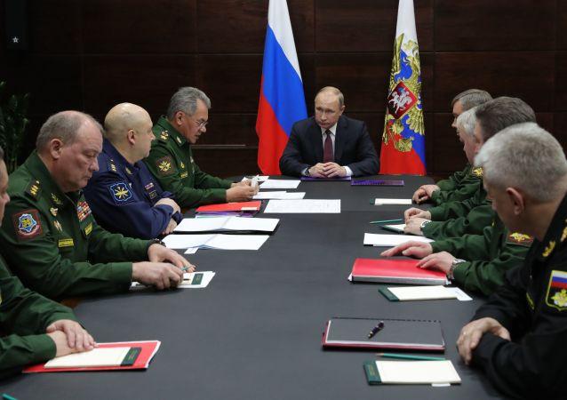Władimir Putin podczas spotkania z przewodniczącym wojsk regionów północnych