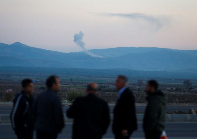 Kłęby dymu nad syryjskim miastem Afrin