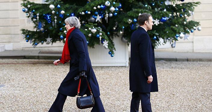 Brytyjska premier Theresa May i prezydent Francji  Emmanuel Macron. 12 grudnia, 2017