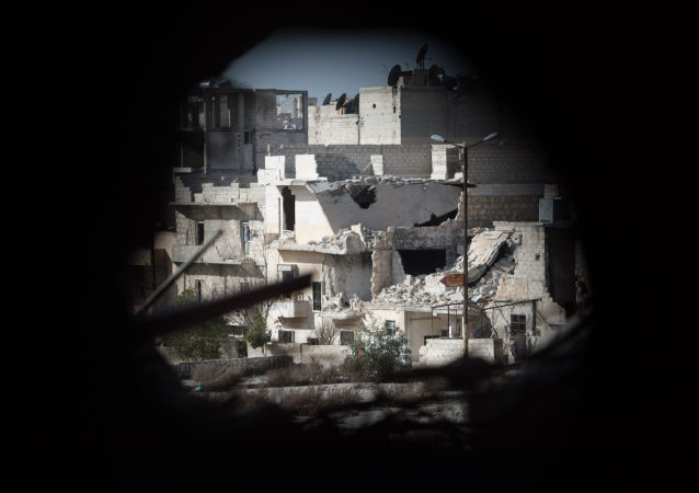 Widok na dzielnicę mieszkalną w Aleppo, przez którą przebiega linia frontu
