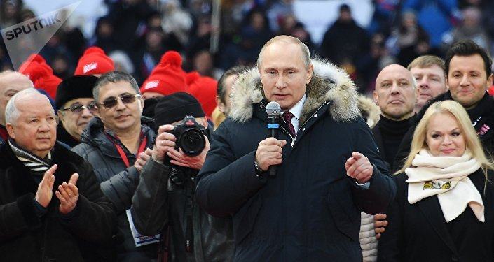 Russian President Putin delivers a speech during a rally to support his bid in the upcoming presidential election at Luzhniki Stadium in Moscow