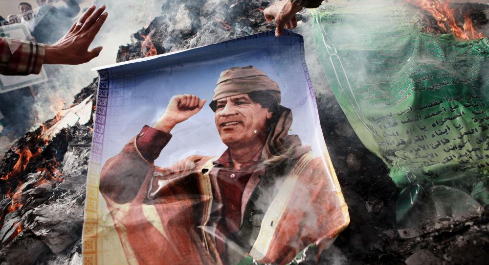 Plakat z podobizną Kaddafiego