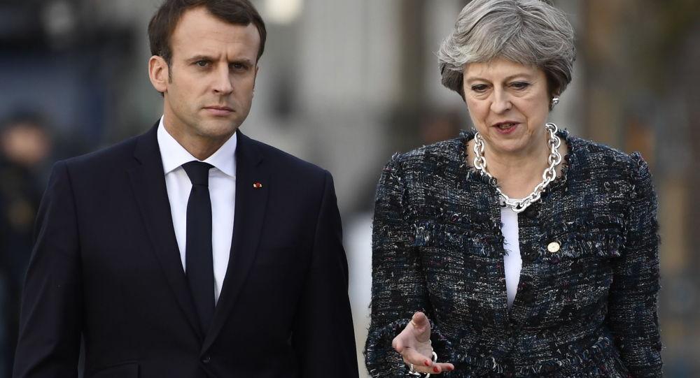 Theresa May i Emmanuel Macron