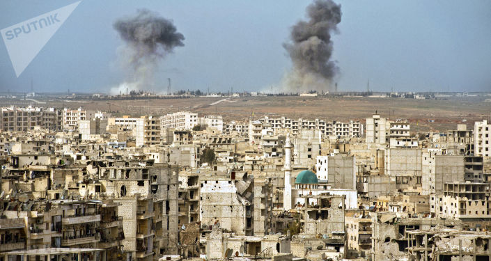 Widok na zburzone dzielnice Aleppo