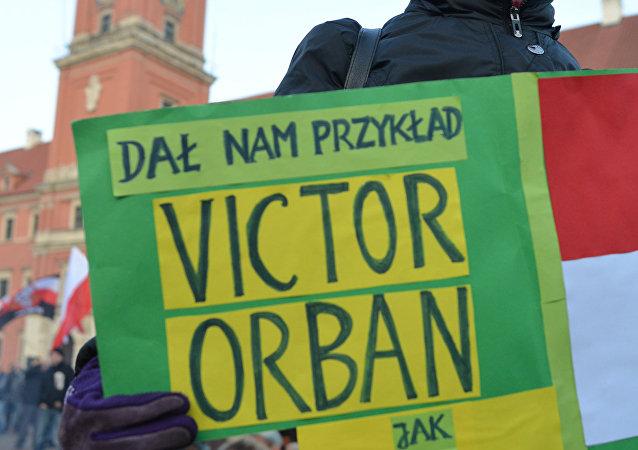 Uczestniczka protestu w Warszawie przeciwko islamizacji Europy