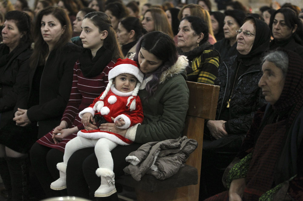 Iraccy chrześcijanie podczas mszy świętej