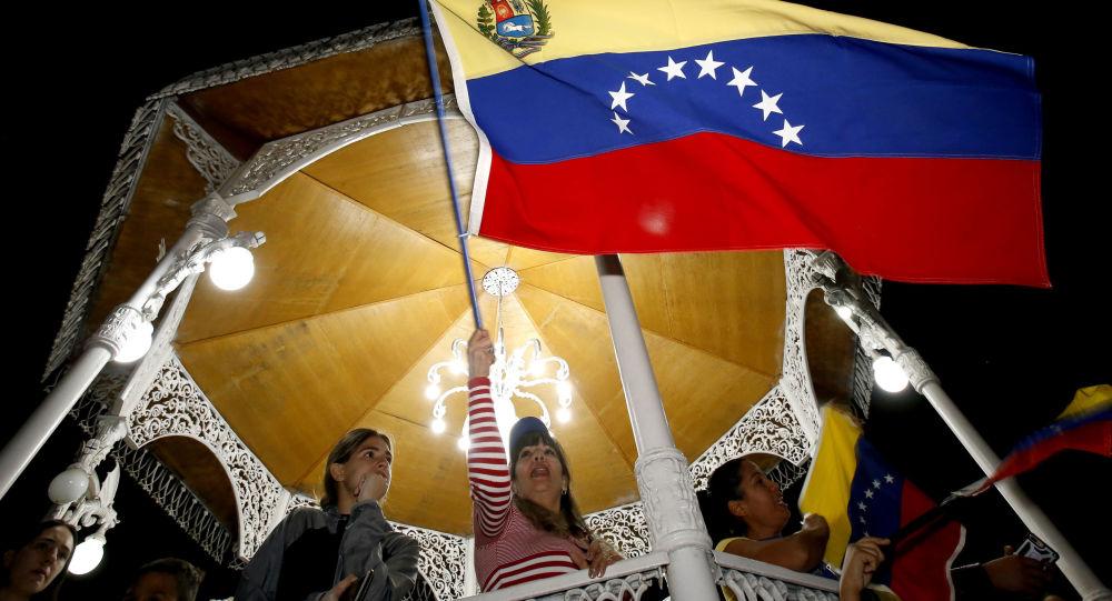 Протестующие против правительства президента Венесуэлы Николаса Мадуро в Каракасе, Венесуэла