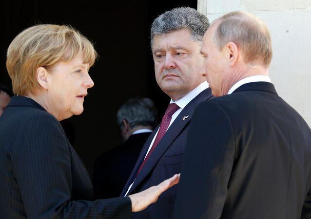 Kanclerz Niemiec Angela Merkel, Prezydent Ukrainy Piotr Poroszenko, Prezydent Rosji Władimir Putin