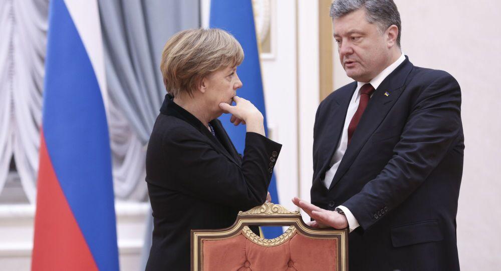 Prezydent Ukrainy Petro Poroszenko i kanclerz Niemiec Angela Merkel na rozmowach ws. uregulowania sytuacji na Ukrainie w Mińsku