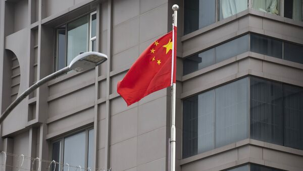 Flaga Chin w pobliżu chińskiego Konsulatu Generalnego w Houston. - Sputnik Polska