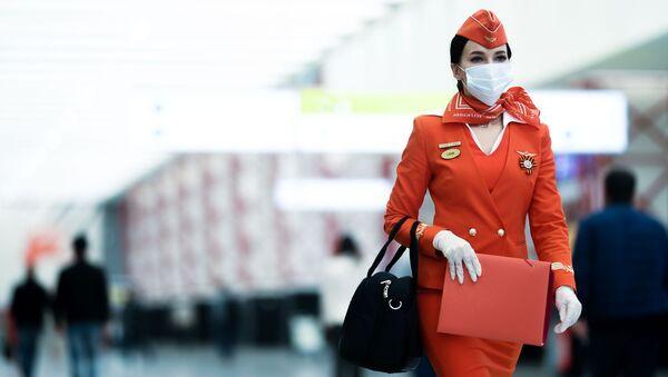 Stewardessa linii lotniczych Aerofłot na lotnisku Szeremietiewo w Moskwie - Sputnik Polska