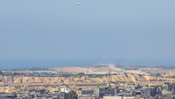 Balony z materiałami wybuchowymi na niebie na granicy z Izraelem i Gazą - Sputnik Polska