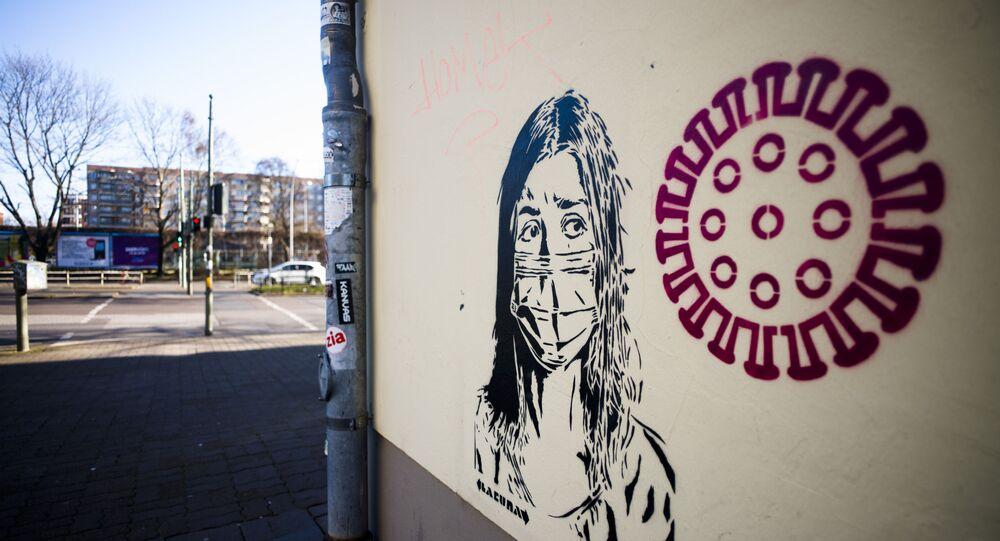 Graffiti poświęcone epidemii koronawirusa w Berlinie