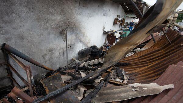 Skutki ostrzału domów cywilów w Górskim Karabachu - Sputnik Polska