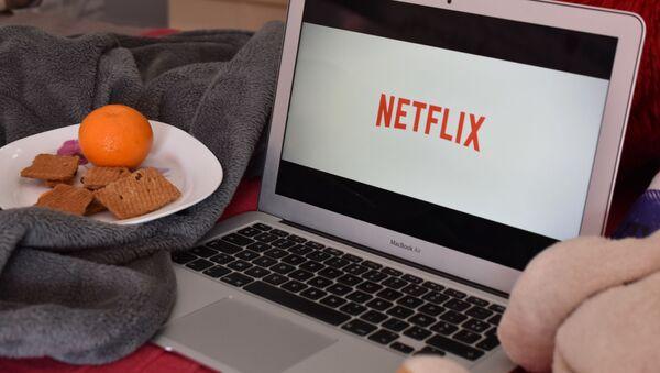Logo Netflix na ekranie laptopa - Sputnik Polska