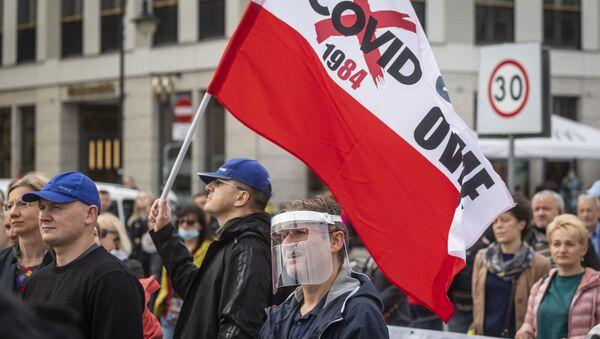 Protesty przeciwników obostrzeń w związku z pandemią w Polsce - Sputnik Polska