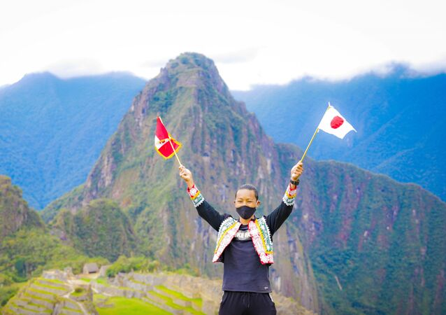 Japoński turysta Jesse Katayama w Machu Picchu