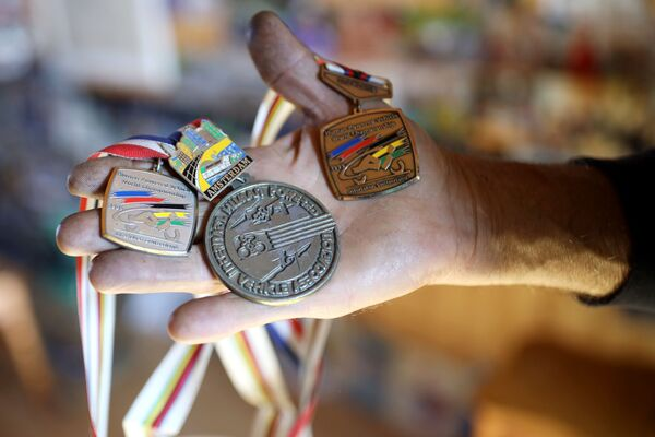 Siergiej Daszewski jest trzykrotnym mistrzem świata w wyścigach rowerowych - Sputnik Polska