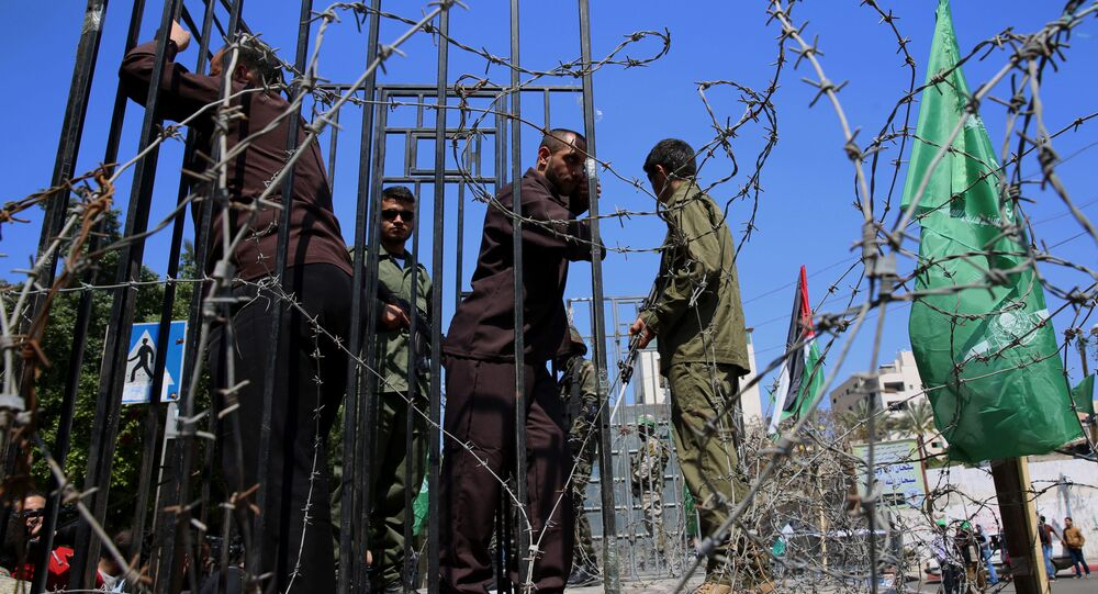 Zamaskowani żołnierze z brygad Izzedin al-Qassam