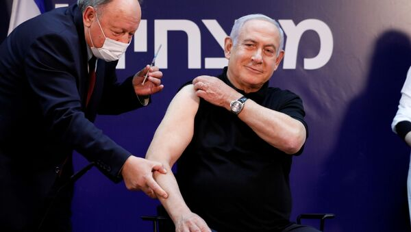 Premier Izraela Benjamin Netanjahu zaszczepił się na koronawirusa SARS-CoV-2. - Sputnik Polska