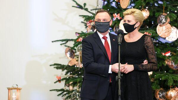 Prezydent Andrzej Duda i jego żona Agatha Kornhauser-Duda podczas uroczystości przekazania Betlejemskiego Światła Pokoju - Sputnik Polska