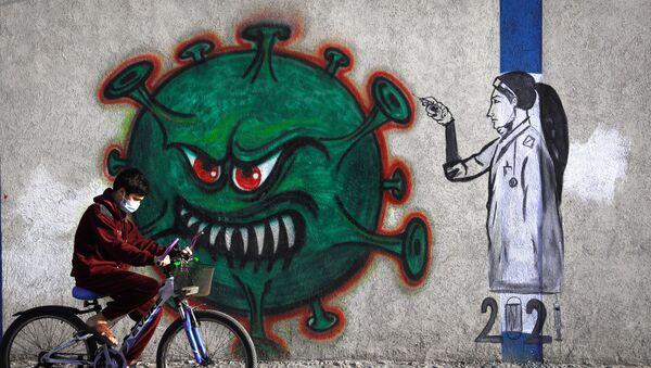 Mural z pielęgniarką i symbolem koronawirusa, Strefa Gazy - Sputnik Polska